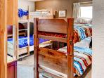 The bedroom, featuring 2 twin-sized bunk beds, is perfect for the kids in your group!