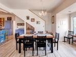 Gather around this large dining table with your companions to enjoy delicious home cooked meals.