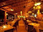 with full beach service, palapas, and live music, as well as open air dining