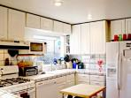 Clean & updated kitchen with filtered cold water, refrigerator, gas stove, etc.