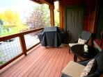 deck area with gas grill and comfy seats