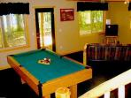 Second living room in walk out basement complete with pool table and PS2 w/games
