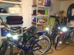 Garage full of beach toys, rafts, chairs, umbrellas, bags, coolers and bikes.
