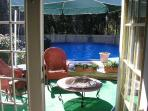 view from french doors to the deck and pool area