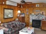 Living room w/stereo, ceiling fan & a/c.