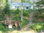Riverfront cottage with deck and dock at the Sand River