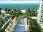 Walk on the beach to the Eden Roc Hotel!