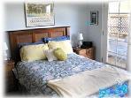 M. bedroom w/ door to deck & sounds of the surf.