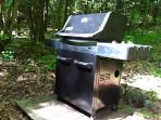 The new 3-burner Weber gas grill with spare tank of propane.
