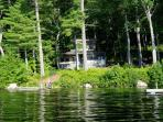 Front of cottage, seen from lake - showing dock (L) and float (R)