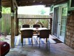 Enjoy morning coffee on the back covered patio and fenced yard for privacy.