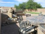 Backyard - Golf/putting green, eating area, swing to watch sunset and Kiva
