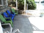 Lower patio seating and swing.