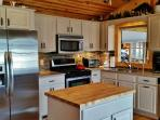 This bright kitchen comes fully equipped with all the essential cooking appliances