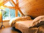 Loft bedroom overlooking the river
