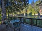 Deck overlooking the Wenatchee River has seating and a gas Weber BBQ and the Hot Tub.