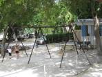 Playground next to swimming pool.