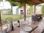 Terrace dining with fully stocked BBQ and pizza oven