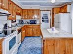 This spacious kitchen comes fully equipped with all the essential cooking appliances