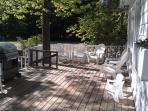 deck, 4 burner gas grill, 11 chairs, 2 child chairs, 2 loungers, 2 picnic tables