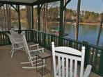Take a seat and enjoy the view on the Screened in Porch.