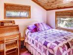 The second bedroom is situated on the opposite side of the house for privacy.