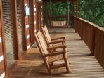 Rockers and a swing on the covered deck. Enjoy the great view, rain or shine