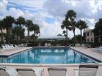 Large pool is only 100 yards away from condo, has seating & bathroom facilities