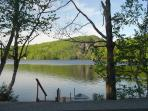 view of lake and dock