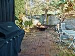 private courtyard with 1500lb. fire pit cooper gate completely private