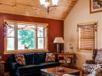You'll love unwinding in the abode's cozy living room.