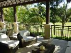 Soak in the tropical sunshine on the large terrace over the golf course.