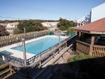 View of pool from front door of condo