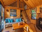 The cedar cabin is sunny and inviting with birch furniture