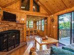 Curl up in the living room next to the stone fireplace