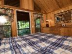 The master bedroom offers its own private entrance to the screened porch and hot tub