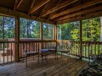 The screened-in porch opens to the main deck and hot tub