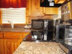 New appliances and granite counter tops in the efficient kitchen