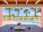 View from shaded lanai to pool.  Great dining area or 'office' away from home.