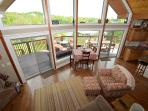 Floor to ceiling windows overlook the lake from the great room and open kitchen