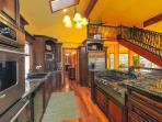 Kitchen features amazing cooking areas and appliances.
