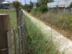 Pathway next to the house provides a convenient and safe 3 min walk to the beach
