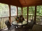 Screened in porch is very private and surrounded by trees.