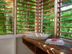 Essence of tropical life: an outdoors bathroom!  This is the upper level of the Garden Cottage