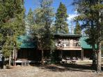 Summer view of Whispering Pines Lodge