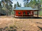 You'll love this cabin's tranquil, secluded setting on 10 wooded acres