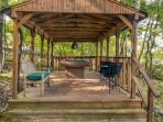 This cabin provides the best of outdoor living! Play pool in the great outdoors with your companions.
