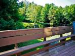 Relax on the large private deck and enjoy the lovely scenery!