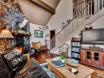 Cozy up by the fireplace while watching your favorite movie on the flat screen TV with DVD player