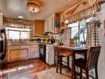 Prepare tasty home-cooked meals in the bright fully equipped kitchen